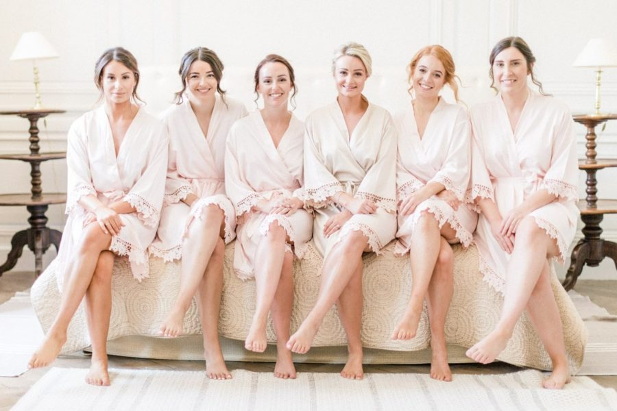 bride and bridemaids in her bed