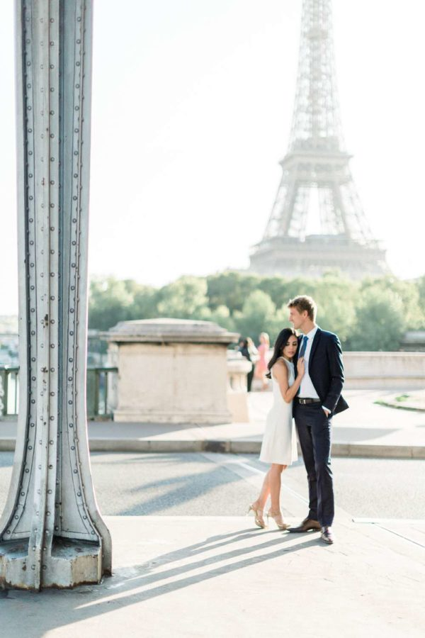 couple front the eiffel tower